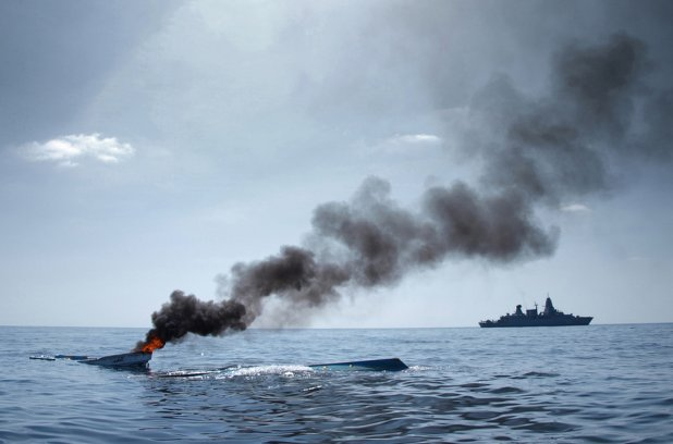 German frigate Hamburg sinks an abandoned skiff off the coast of Somalia. Credit: Christian Bundeswehr - Reuters